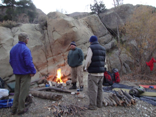 Kyle, Willow and Erik gather around the fire on the second night of our trip. Behind the sandstone wall and up a hill is where i came across the trash and the eco-toilet.