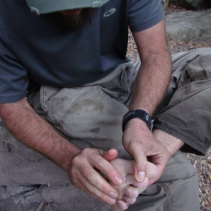 Erik inspects his feet at the West Fork Camp